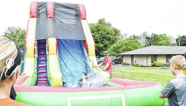Urbana Junior High students enjoy a slide with a pool at the bottom during the school's annual Field Day fun day on Wednesday.