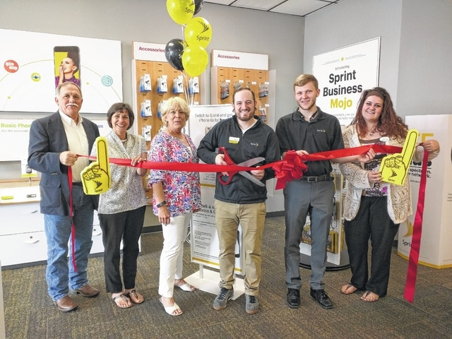 The Champaign County Chamber hosted the opening of the Urbana branch of Sprint by Preferred Wireless at 682 Scioto St. From left are Larry Krugh, Jenny White, Chamber Executive Director Sandi Arnold, Sprint Wireless Manager Richard Woodruff, Codey Meade and Heather Martin.