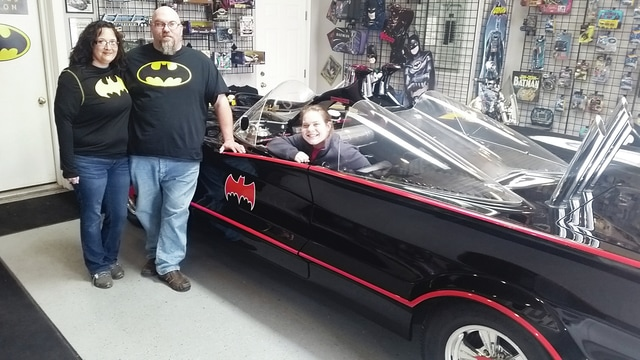 "This year's local American Cancer Society Relay for Life theme is ""Superheroes"" and one of the highlights will be a Batmobile on display at Relay on May 20 and 21 at the fairgrounds. People will be able to take pictures of the car or pictures inside the car for a donation. It's being provided by Carl's Body Shop in Dayton. Pictured is local Relay for Life event leader Scott Engle and his wife Lisa with Nora O'Connell seated in the car. Scott Engle orchestrated the car's upcoming appearance at Relay. O'Connell is the Relay for Life community manager, east central division, of the American Cancer Society."