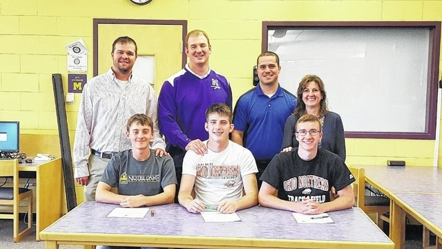 Mechanicsburg's Joey Butsch, David Harvey and Jared Butcher each recently signed a letter of intent. Pictured are Joey Butsch, David Harvey, Jared Butcher, Coach Eyink, Coach Forrest, Coach Cahill and Coach Dietrich.