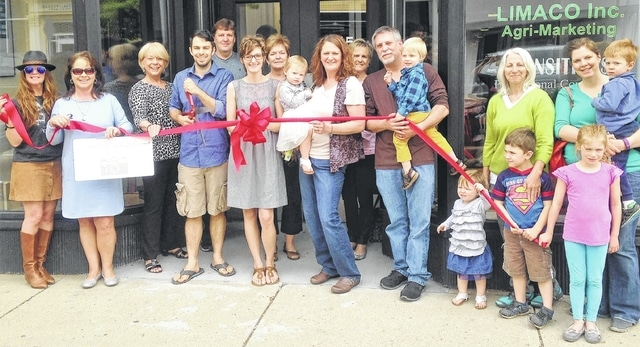 The Champaign County Chamber and Champaign Economic Partnership co-hosted a celebration for the May 20 grand opening of Ashley Roberts Photography at 115 N. Main St., Suite F, in Urbana. For more information on past or future ribbon cuttings, call 937-653-5764. From left are Pam Bowshier, Kay McOwen, Chamber Executive Director Sandi Arnold, Caleb Roberts, Kris Carroll, Ashley Roberts, CEP Executive Director Marcia Bailey, Brenda Knepper holding Gemma Roberts, Laurie Minnock, Eric Knepper holding August Roberts, Melody Roberts, Debbie Roberts, Eli McCarty, Emily McCarty holding Reese McCarty, Avery McCarty.