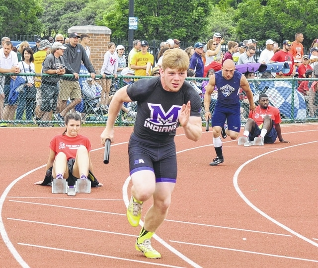 Mechanicsburg's Dustin Knapp breaks away from the blocks in the 4x200 relay at state on Saturday. The Indians finished 9th.