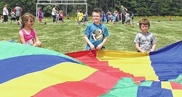 First grade students in teacher Carnes' class have fun with a parachute during Graham Elementary's Field Day. The event was held for grades 3-5 on May 24 and for grades K-2 on May 25. Physical education teachers Rob Blosser and Ty Jacobs organized the two-day event. Teachers and parents helped make the fun end-of-year event a success.