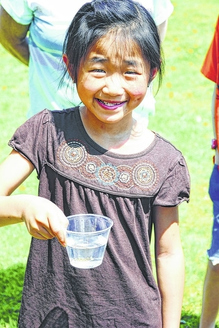 Elementary students released brown trout fingerlings into a Mad River tributary.