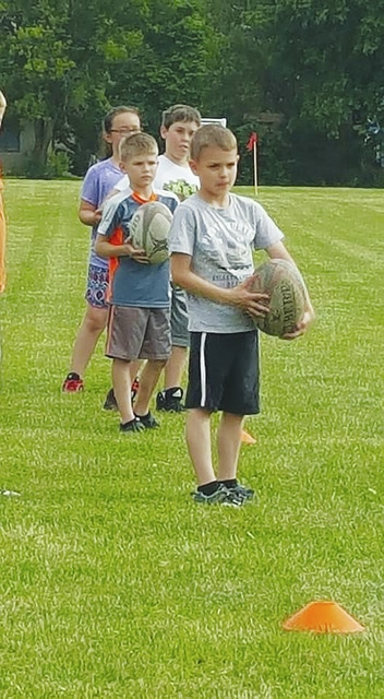 Youth rugby in Urbana is off to a good start after last Wednesday's practice. Registrations are still open. The next practice/registration day will be Wednesday at 5 p.m. at the Melvin Miller Park soccer fields. Registration is available to all area boys and girls, ages 7-14 (2nd - 8th going on 9th grade). Registration is $20. Players will be grouped into two age groups set to compete in flag rugby on Sundays through June and July. Pictured are Brayden Shuster and Aiden White from last week's practice.