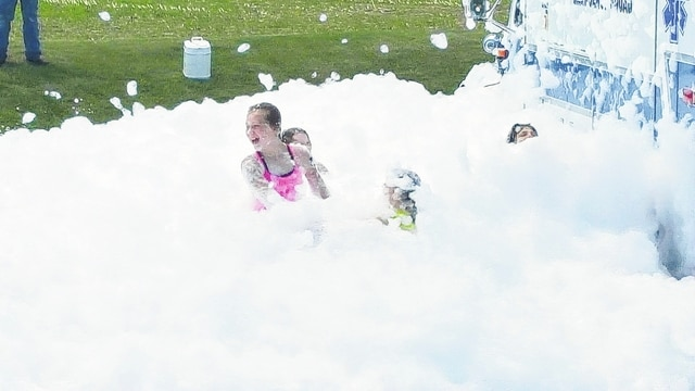 """Johnson-St. Paris Fire District coordinated a """"drug drop-off"""" day and children's safety event on Saturday. Pictured are local kids playing in recreational foam on the 92-degree afternoon. CareFlight participated in the event with their mobile ground unit, the Champaign County Sheriff's Office completed Ident- A- Kid on approx 30 children and the St. Paris Police Department collected 58 pounds of prescription medication in the drug drop-off program. Overall it was a successful and fun day, according to event organizers."""