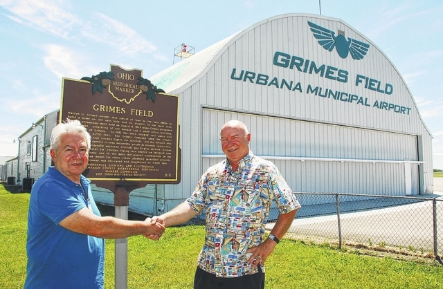 Elton Cultice, left, shakes hands with outgoing Grimes Field Airport Manager Lou Driever. Cultice, who will take over for Driever on July 1, is a graduate of Urbana High School.