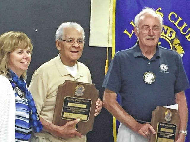 Urbana Lion President Elaine Dyer presents Melvin Jones Fellowship Awards to Lion Ed Corwin, center, and Lion Dale Long for their many years of service to the community and to the Lions Club.