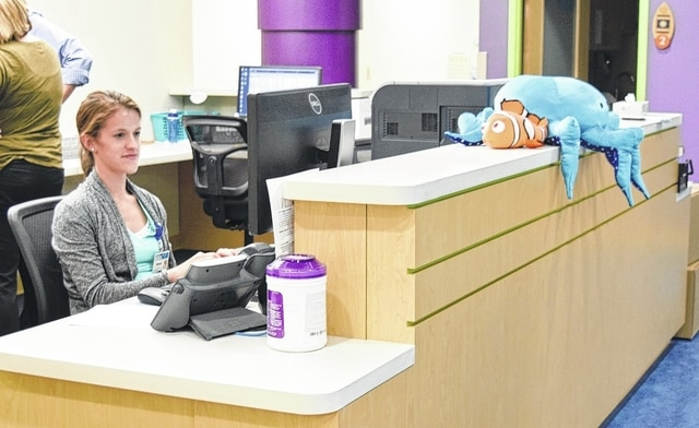Nurse Practitioner Alyssa Studer prepares for patients at the new Urbana Family Medicine and Pediatrics office, formerly Mercy Well Child Pediatrics. The practice is growing with the addition of family practice Dr. Jeffery Bowers, beginning July 5.