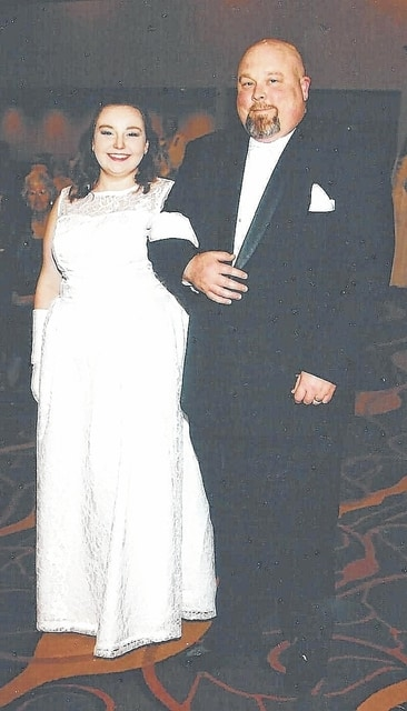 Ohio Society Daughters of the American Revolution debutante Rachel Ebert, of Urbana, is escorted by her father, Richard Ebert, across the Grand Ballroom at a DAR event.
