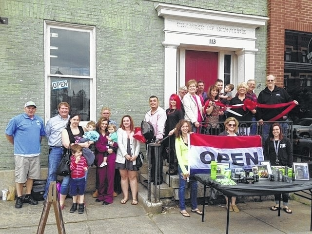 The Champaign County Chamber and friends celebrated the grand re-opening of Roxy's Hair Studio at its new location, 113 Miami St. in Urbana, on May 13. Shown are Stephen Valley, Chamber & CEP board member Kyle Hall, Annalisa Jenkins holding Seely Jenkins, Lochan Jenkins, Wayne Fraley, Maranda Fraley holding Gwen Nicolas, Ruth Holland, Brandon Hall, Amber Wilson, Martin Dale Schafer, CEP Executive Director Marcia Bailey, Brett Wilson, Roxy Fraley, Jared Harshbarger holding Layne Harshbarger, Chamber Executive Director Sandi Arnold, Jerry Osborne, Mike White and, in front of table, Brianna Duben, Holland Sears and Amber Seagraves.