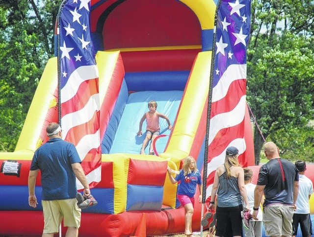 Sully Uhl goes down the giant inflatable slide during ParkFest on Saturday at Melvin Miller Park. There were activities of all kinds for all ages during the event.