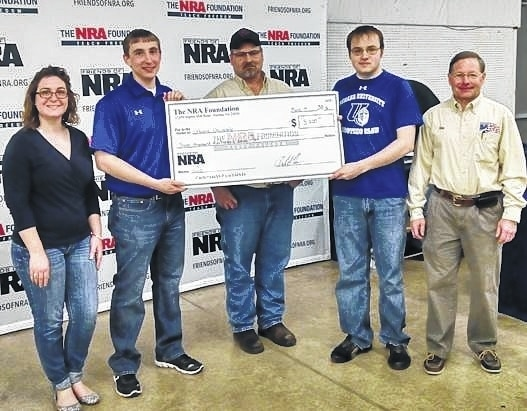 """Urbana University's Shooting Sports Team received a gift from the NRA Foundation. Distributed through the West Central Ohio Friends of the NRA, the funds will be used to purchase competition pistols. According to Ken McCabe, coach of the shooting sports program, """"The tremendous support we have received from the NRA Foundation has helped to transform the shooting sports program here at the university. As a result of this gift, our students use excellent equipment and will be equipped to compete with some of the premier teams in the region."""" Team members and others, from left, are Emily Davis, Seth Collier, FNRA Chairman Jerry Blosser, Kenny Sharp, Coach Ken McCabe."""