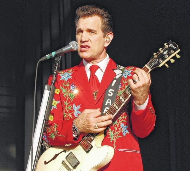 A rhinestone sparkles into a starburst on Chris Isaak's right lapel as the evening sun streams onto the stage at Rose Music Center on Tuesday night.