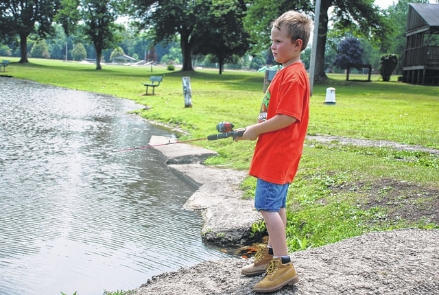 Lane Daniel, 6, casts his line into the fishing pond at Melvin Miller Park in Urbana. Children are enjoying a long, warm summer break from classes.