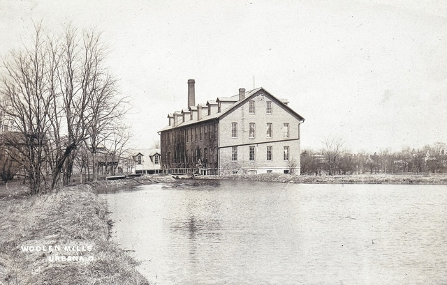 """This ca. 1914 photo post card shows the """"old wollen mill"""" in the East Water Street building that now is home to Russell T. Bundy Associates Inc."""