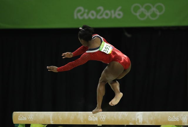 United States' Simone Biles stumbles during her performance on the balance beam during the artistic gymnastics women's apparatus final at the 2016 Summer Olympics in Rio de Janeiro, Brazil, Monday, Aug. 15, 2016. (AP Photo/Dmitri Lovetsky)
