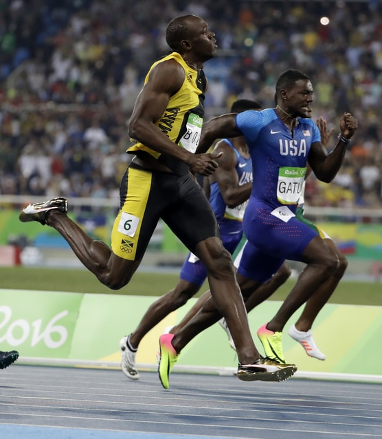 Jamaica's Usain Bolt leads in the men's 100-meter final leads United States' Justin Gatlin during the athletics competitions of the 2016 Summer Olympics at the Olympic stadium in Rio de Janeiro, Brazil, Sunday, Aug. 14, 2016. (AP Photo/David Goldman)