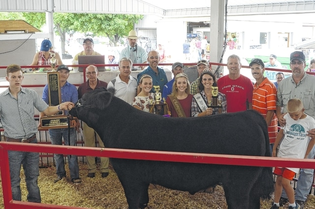 Colby Watson's Champion Market Steer sold for $4,000 to a syndicate of buyers.
