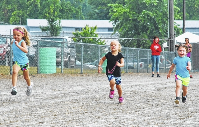 A wet and muddy track on Wednesday didn't stop area youth from taking part in the Pepsi Cola Youth Day Activities at the Champaign County Fair. Pictured are several youth ages 4 and under taking part in the 50-yard dash.