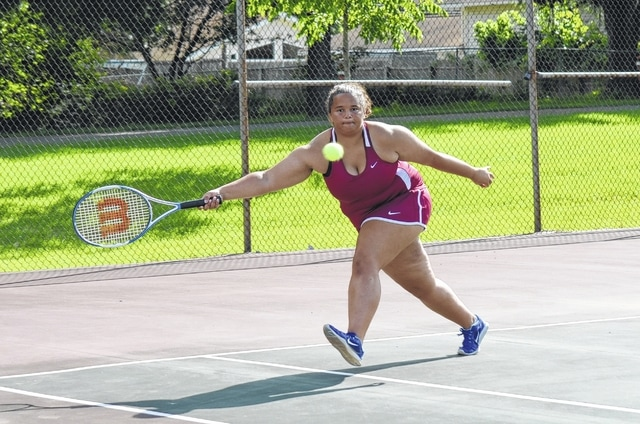 Urbana's Haylee Johns lunges for a ball during first singles competition against Sidney on Monday at Melvin Miller Park. The Hillclimbers lost, 3-2, but Johns won her match in three sets.