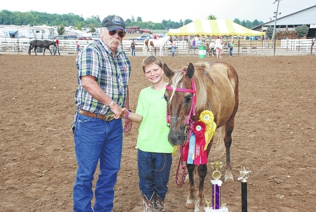 Karson Meeker was the Junior Overall Champion Age 8-10. His horse brought $100 in sponsorship from Shoaf Quarterhorses.