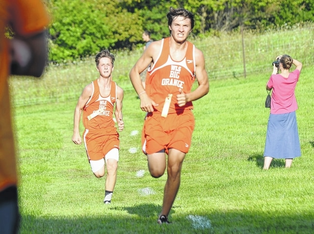 West Liberty-Salem's Michael Conley (right) and Noah Smith dash to the finish line at Tuesday's Logan County Meet. Smith actually passed Conley at the line to take second place, while Conley finished third. Teammate Nick Williams was fourth.