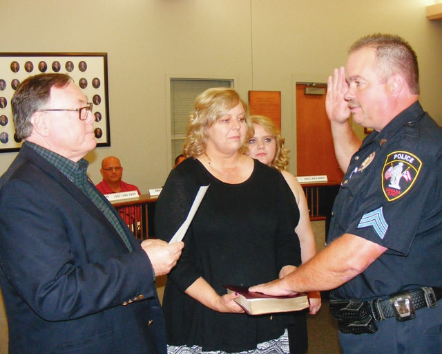Christopher P. Snyder, right, was sworn in as a sergeant for the Urbana Police Division during Tuesday's Urbana City Council meeting by Mayor Bill Bean. In attendance for the swearing-in were Snyder's wife, Mary Kay, and daughter Courtney.