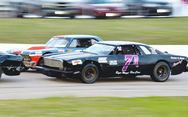 Rodney Roush (7R) of Sidney battles with DeGraff's Buck Purtee at Shady Bowl recently. Roush holds a nine-point lead over Purtee in street stocks as they head into the final points race this season Saturday night.
