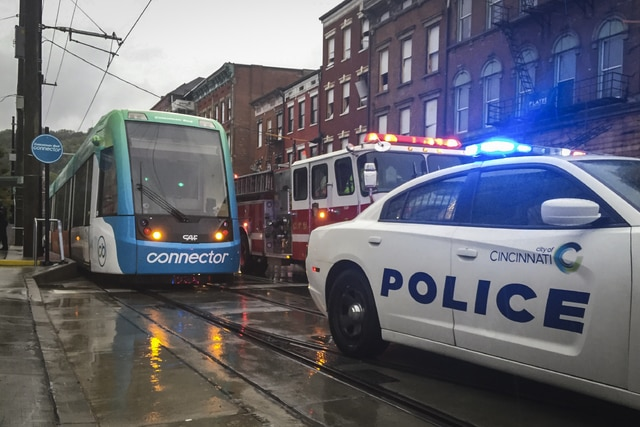 The Cincinnati Bell Connector is shut down after authorities cleared the streetcars following a bomb scare , Saturday, Sept. 10, 2016, in Cincinnati. City of Cincinnati spokesperson Rochy Merz stated in a release that all five streetcars were evacuated and searched by bomb sniffing dogs after an anonymous caller claimed an explosive was placed on one of the vehicles. (AP Photo/John Minchillo)