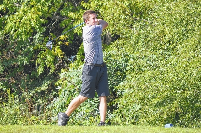 Mechanicsburg's Corey Bogan hits a tee shot at Indian Springs on Tuesday. The Indians narrowly defeated OHC rival West Liberty-Salem and visiting Madison Plains.