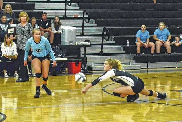 Graham's Carly Carafa makes a diving dig Thursday night versus Benjamin Logan while teammate Claire Comer (10) watches.