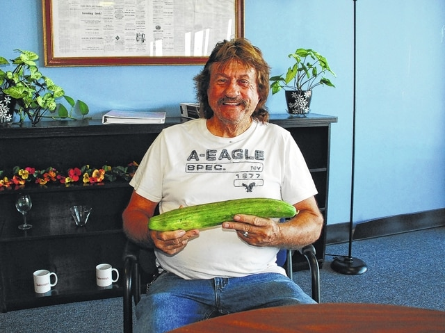 Urbana resident Stanley Gilliam Sr. recently discovered a giant English cucumber buried under vegetation in his vegetable garden on James Avenue. Gilliam said he was surprised when he stumbled upon the cucumber.