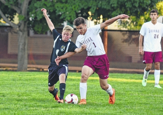 Urbana's Ethan Edwards battles for possession of the ball during Monday's soccer match.