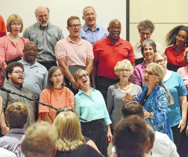 The World House Choir, under the direction of Dr. Catherine Roma, performs at the Urbana University Student Center for the 2016 Alicia Titus Memorial Peace Fund.