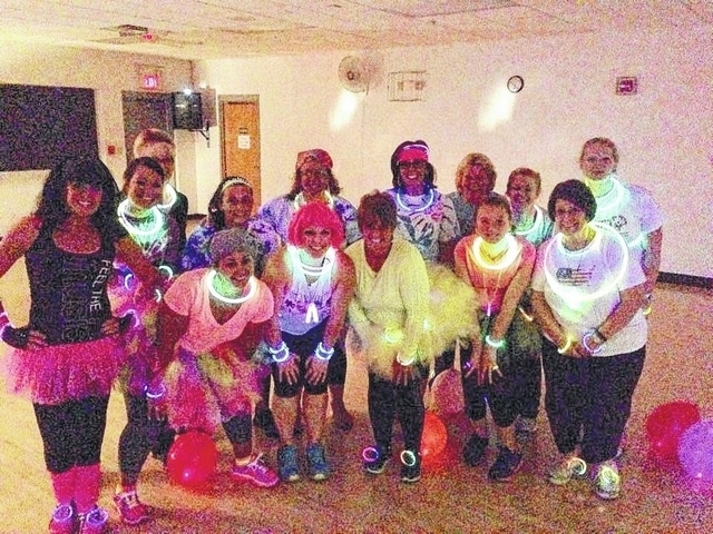 Come glow like these ladies during Tuesday evening's Passport to Wellness event at Graham High School.