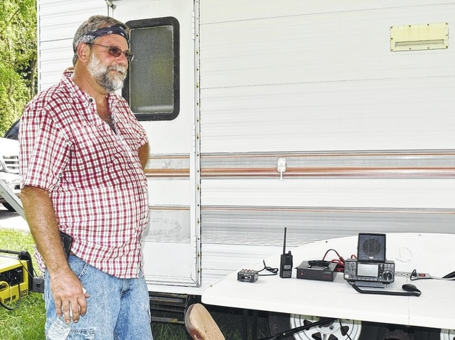 Ham radio enthusiast Ron Hunt shows some of the tools of the trade. He is part of the Champaign Logan Amateur Radio Club, which competes against other groups across the state to score the most contacts.
