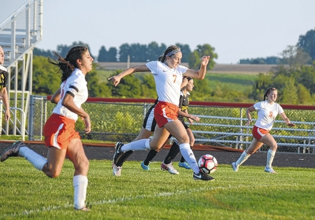 The West Liberty-Salem forwards attack, led by Gabby Hollar (7) in the center. The Tigers were relentless against Botkins on Tuesday, pushing the ball repeatedly toward the Trojans' goal.
