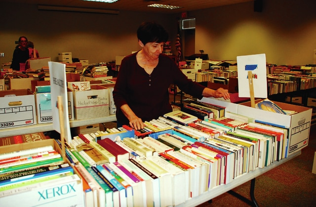 In preparation for the upcoming Friends of the Champaign County Library Book Sale, Marge Kitchen sorts through a table full of health-related books. The sale will take place from 9 a.m. to 8 p.m. on Friday and 9 a.m. to 3 p.m. on Saturday at the Champaign County Library located at 1060 Scioto St. in Urbana.