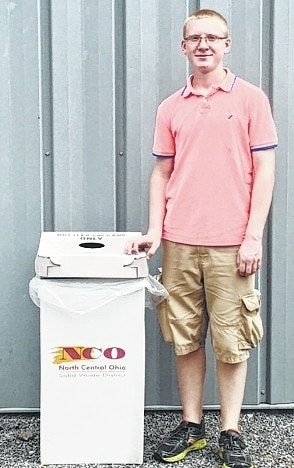 Mechanicsburg FFA student John Kent shows off one of the recycling bins at the fair.