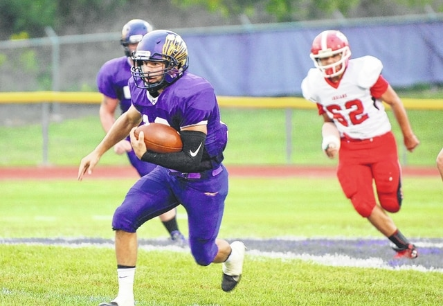 Mechanisburg quarterback Kaleb Romero dashes for yardage in a Sept. 16 game against visiting Cedarville. Romero broke two school records during the game: one for career points scored and the other for yards passing.