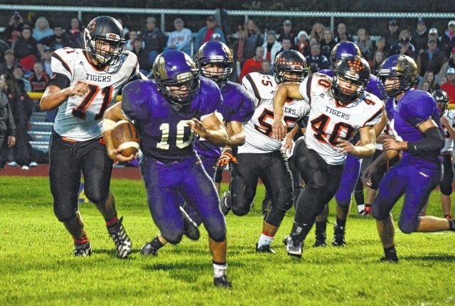 Mechanicsburg's Kaleb Romero (10) runs away from the West Liberty-Salem defense on Friday at Mechanicsburg High School.