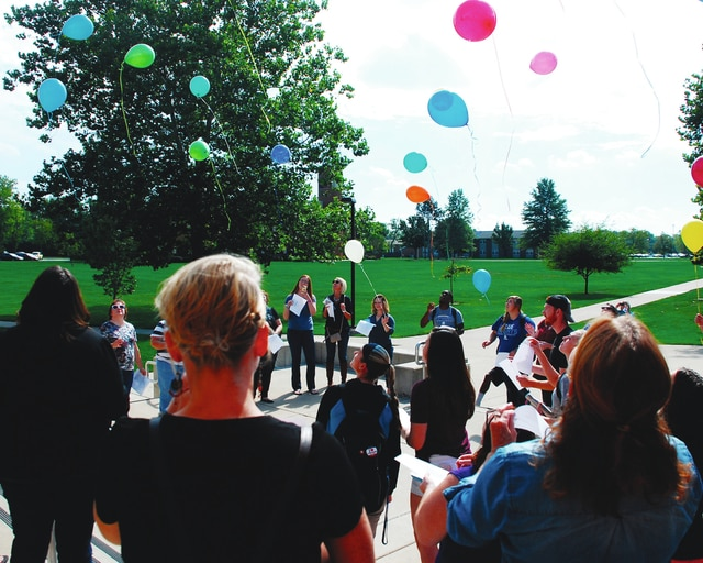 Attendees at Friday's Suicide Awareness Ceremony look up during the balloon release at the end of the ceremony. The annual ceremony honored Champaign County residents who lost their lives to suicide while offering support and healing for the friends and families of people who have lost someone to suicide.