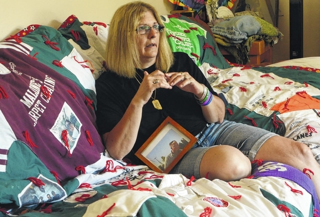 Carmela Wiant sits on a quilt made of her son's old shirts and recalls what it was like to hear her son, David, had died in an automobile accident.