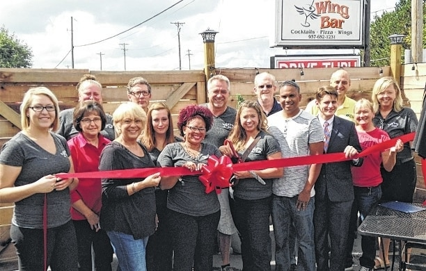 The Champaign County Chamber hosted a ribbon-cutting and celebrated the grand opening of Wing Bar at 1549 S. U.S. Route 68 in Urbana on Sept. 9. For information on past or future ribbon-cuttings, call the Chamber at 937-653-5764. From left are Kasey Shank, Ellen Pond, Kellie Ray, Chamber Director Sandi Arnold, Ty Henderson, Nicole Lockard, Megan Snapp, owner Mike Fraley, Manager Amber Weaver, Mike White, Aaron Weaver, Joshua Tovey, Shane Seidenstricker, Liela Anderson and owner Kim Fraley.