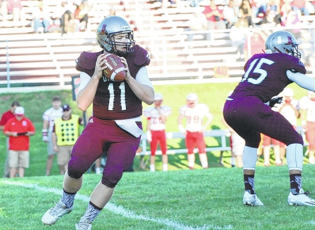 Urbana quarterback Preston Shields (pictured) looks to pass during last week's game with Stebbins.