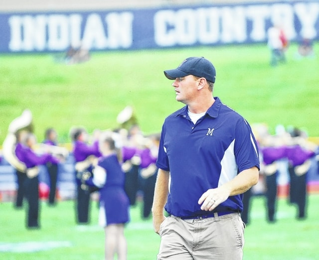 Mechanicsburg Coach Kurt Forrest watches his team assemble for the start of the Sept. 16 game against visiting Cedarville.