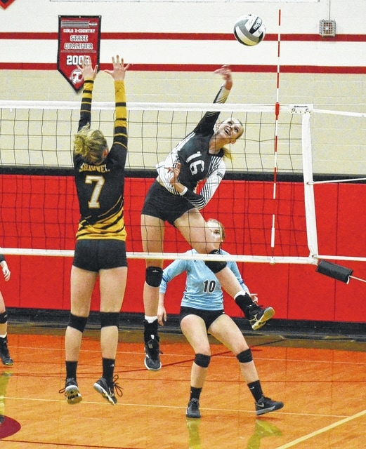 Graham's Kaitlin Trace slams a ball down the line on Wednesday against Shawnee. Trace led the Falcons with 11 kills and 3 aces.