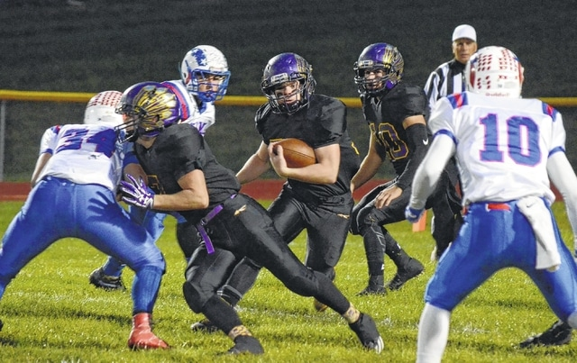 Mechanicsburg's Dustin Knapp finds a hole up the middle for the Indians during Friday's game with Greeneview.
