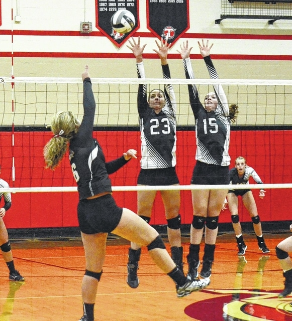 Graham's Macy McCool (23) and Katie Milligan (15) attempt to block a ball played by Bellefontaine's Kiersten King Monday night in the Division II sectional tournament at Tecumseh.